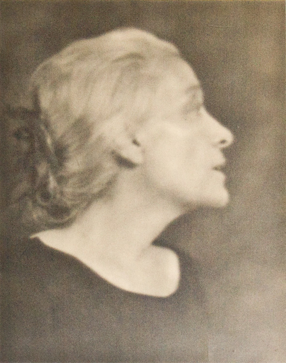 ELEONORA DUSE: Fine head and shoulders portrait photograph of the actress, with the photographer's label on verso. Gelatin silver print on smooth paper. Arnold Genthe.