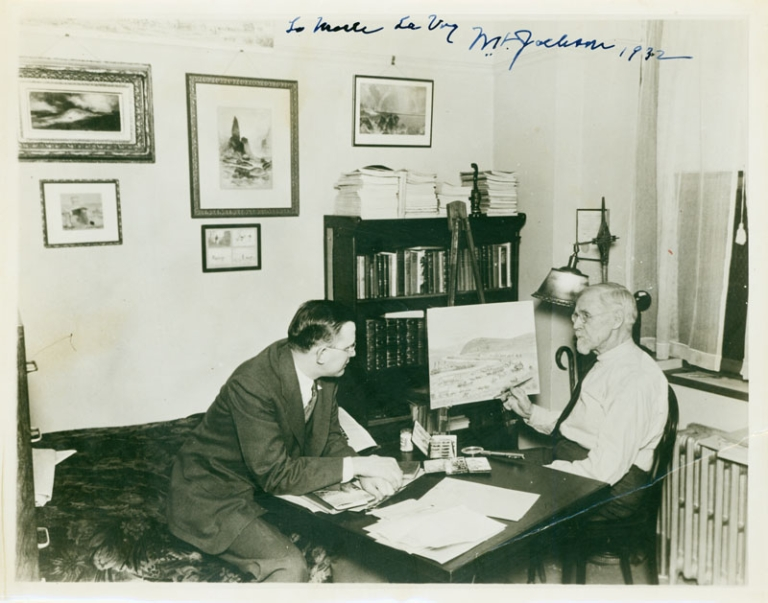 """William A. Jackson: Photograph of the celebrated Western artist, seated painting in watercolor at his easel at home, in the company of famous photographer Merle La Voy, inscribed """"To Merle La Voy, Wm. A Jackson, 1932"""" at top. William A. Jackson."""