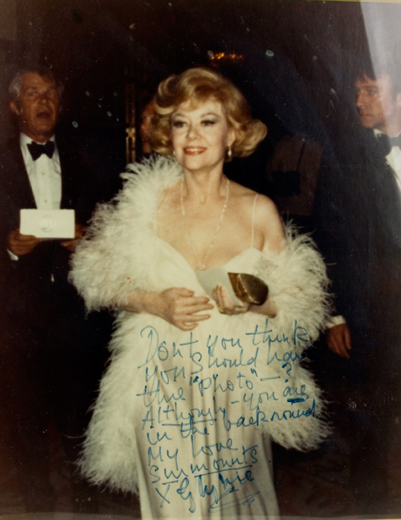 Color photograph of Glynis Johns receiving a Tony award in 1974 for A LITTLE NIGHT MUSIC, with Hugh Wheeler and Christopher Plummer (?) in the background. Glynis Johns.