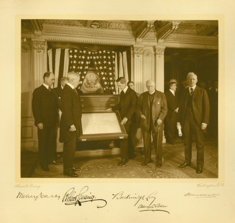 Photograph of Secretary of State Robert Lansing and His Colleagues: Wilbur J. Carr, Breckinridge Long, Alvey A. Ader, and one other, signed in ink on the mount. Robert Lansing.