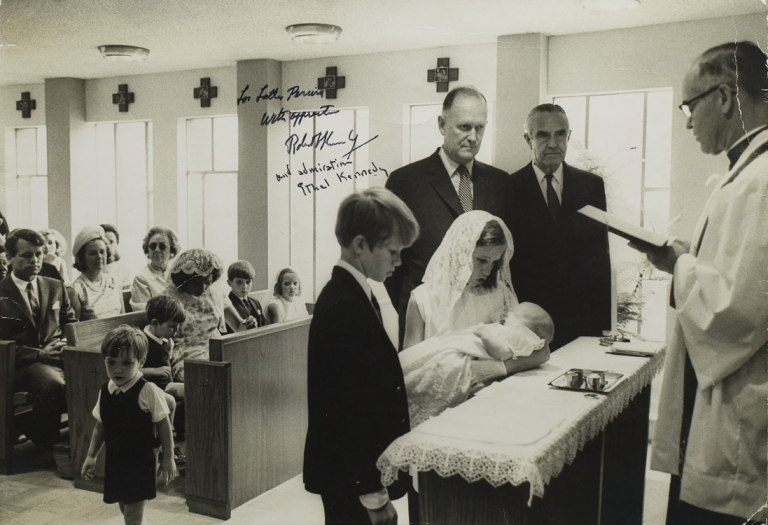 """Photograph of the baptism of Douglas Harriman Kennedy. with Averell Harrimann as Godfather signed and inscribed by RFK """"To Father Pereira/ with appreciation/' Robert Kennedy/ and admiration Ethel Kennedy (in her hand). Robert F. Kennedy."""