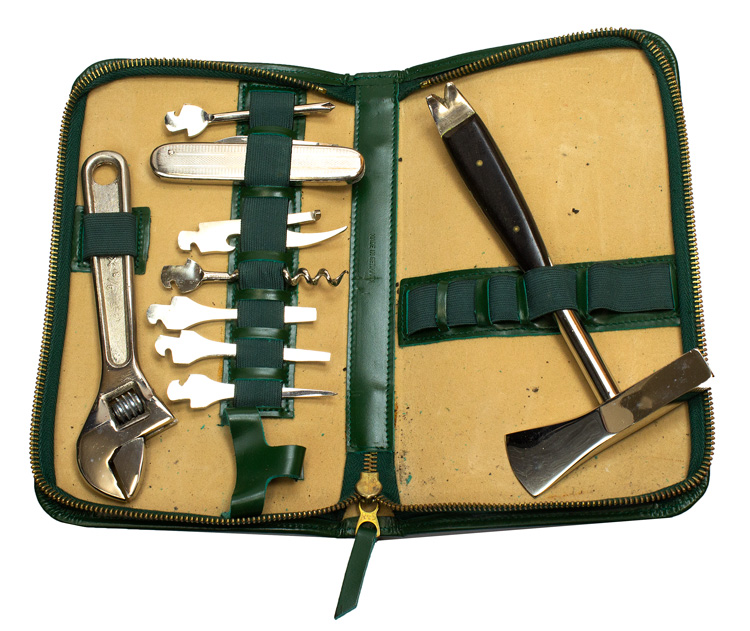 "Master's Marterial from the Collection of Estate of Clifford Roberts including personal grooming men's set in green calf box stamped in gold ""Master's-1964"" ; tourqouis clasp purse with gilt stamped metal clasp with Master's logo, ""Made in Italy"", mint in box ""Spaulding & Co, Jewelers...Chicago; nother, in sleeve; Silver Triffet from Garrards in box, etc. Master's Golf Tournament."