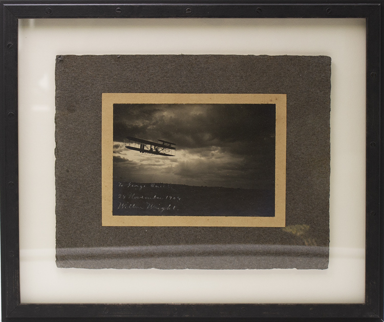Photograph of Wilbur Wright in a Wright Flyer at twilight. Wilbur Wright.