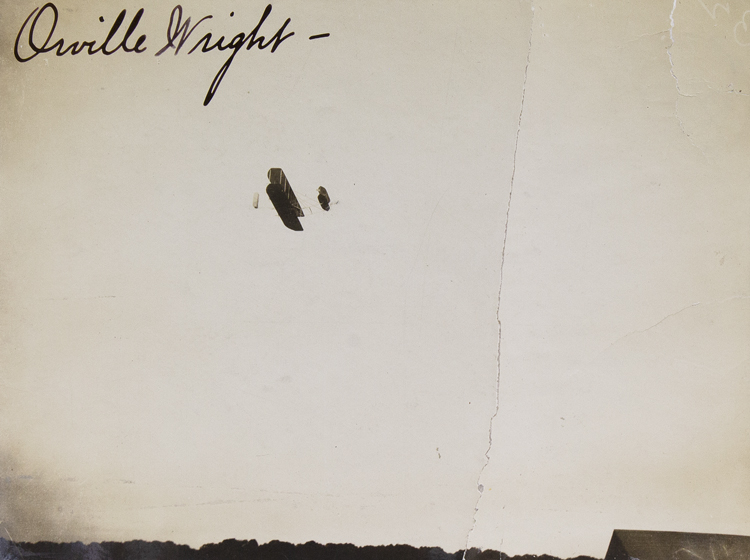Photograph of the Wright Flyer in flight, signed by Orville. Orville Wright.