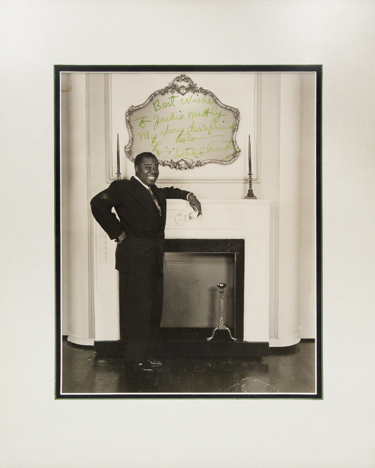 "Photograph signed and inscribed in the image (""Louis 'Satchmo' Armstrong), to Jackie ""Moms"" Mabley, ""Best wishes to Jackie Mabley, my dear friend ... "" Louis Armstrong."