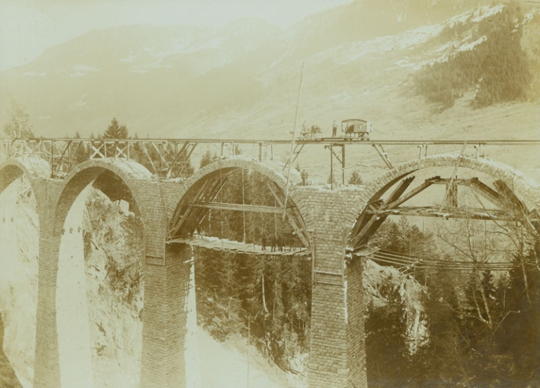Six Photographs of the construction of an Alpine bridge across a pass in the Swiss Alps. Swiss Alps.