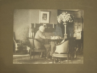 Photograph of J.P. Morgan seated at his desk, in profile