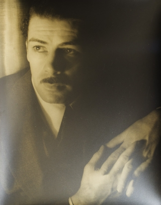 Portrait photograph of Paul Muni