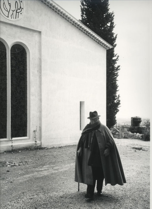 Portrait of Henri Matisse taking a stroll in front of the Chapelle Matisse in Vence. Henri Matisse, Dmitri Kessel, photographer.