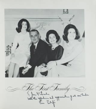 "Photograph of the President, seated in a chair beside author Robert Ruark and another official, before a table of African souvenirs, Inscribed ""To Bob Ruark, whose perceptive views of the world keeps [sic] us all on our toes, Lyndon B. Johnson"""