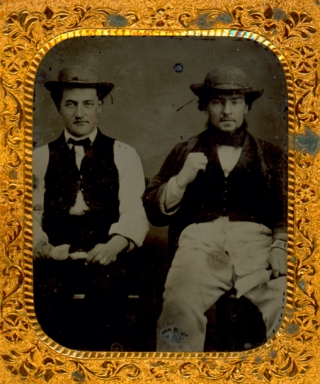 Occupational ambrotype of two house painters, with brushes in hand. Ambrotype, H. J. Ellicott.