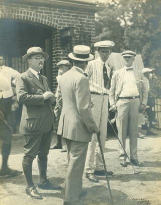 Photograph of Jim Barnes conversing with other golfers [with:] Photograph of two unidentified golfers. Golf, Edwin Levick, photographer.