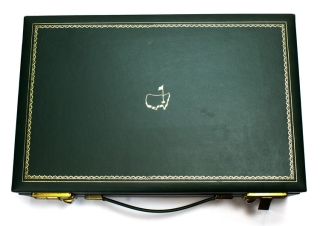 "Master's Marterial from the Collection of Estate of Clifford Roberts including personal grooming men's set in green calf box stamped in gold ""Master's-1964"" ; tourqouis clasp purse with gilt stamped metal clasp with Master's logo, ""Made in Italy"", mint in box ""Spaulding & Co, Jewelers...Chicago; nother, in sleeve; Silver Triffet from Garrards in box, etc"