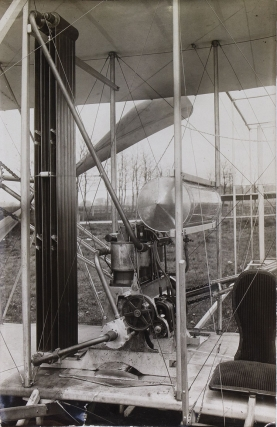 Photograph of Orville Wright with Major Albert B. Lambert seated in the Wright Flyer, 1910, signed by Orville Wright at the right area of the image