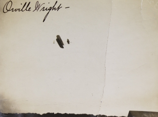 Photograph of the Wright Flyer in flight, signed by Orville