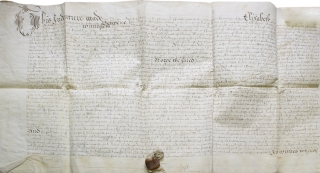 Manuscript indenture from the reign of Queen Elizabeth I of England between John Bert and Thomas...
