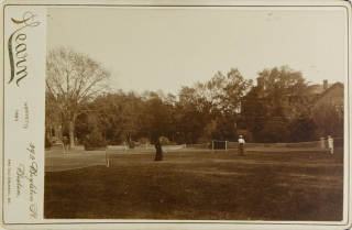 Photograph of 4 women playing lawn tennis