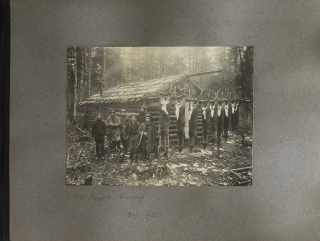 Photograph album depicting hunting, fishing, canoeing, and camping in Canada and Maine