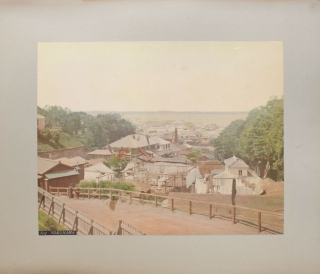 Album of Japanese 8 hand-coloured photographs and 14 others mostly Mexican including birds eye view of the city of Zacatecas, Statues of Guitlahuac, Hotel del Jardin, water carere, La Viga tipped into an album