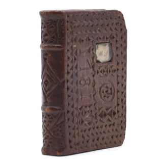 Chip-carved wooden book-form, dated 1781 on upper cover with small inlaid manuscript initials...