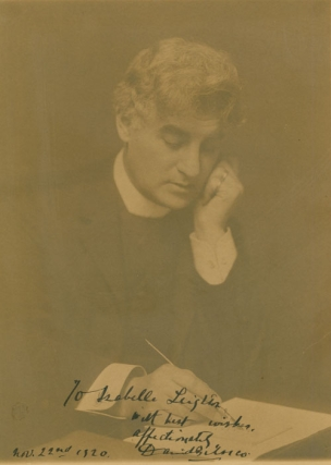 Portrait photograph of David Belasco writing with quill pen. David Belasco, The Misses Selby