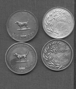 Set of four engraved championship dog medals, awarded by the American Kennel Club and the...