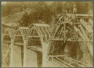Six Photographs of the construction of an Alpine bridge across a pass in the Swiss Alps